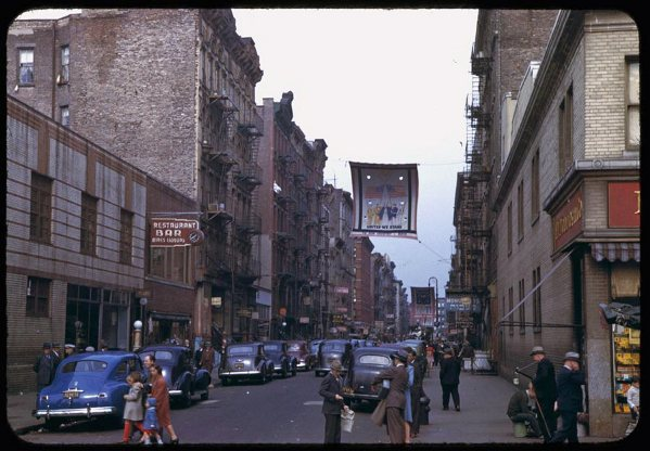 two-views-looking-up-a-street-of-many-races-lower-manhattan-1942.jpg