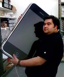genius_holding_iphone.jpg