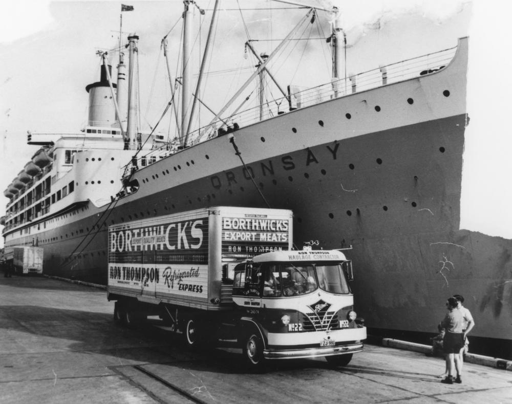 StateLibQld_1_137220_Borthwick's_export_meat_truck_alongside_the_Oransay_at_a_Brisbane_wharf.jpg