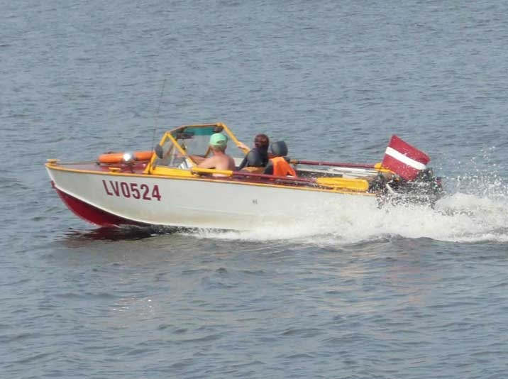 Soviet era PG-117 speedboat on the Daugava river in Riga.jpg