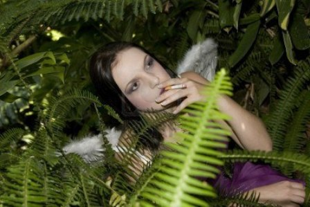 943475-beautiful-brunette-evil-fairy-busy-smoking-a-cigarette-in-between-plants.jpg