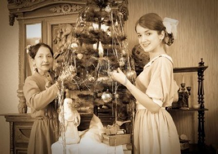 7873620-vintage-photo-of-daughter-with-mother-decorating-christmas-tree-at-home.jpg