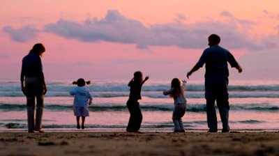 stock-footage-three-children-and-two-adults-jump-on-the-beach-at-sunset.jpg