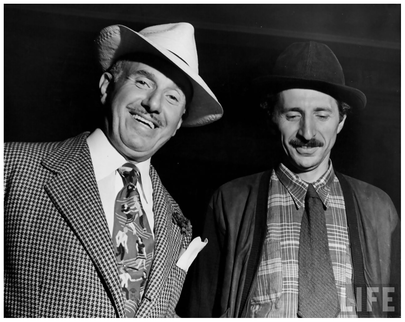 photographer-gjon-mili-r-w-warner-bros-studios-head-jack-l-warner-on-set-of-22jammin-the-blues22-film-being-directed-by-mili-1944.jpeg