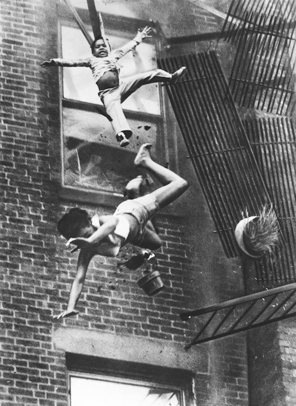 a_mother_and_her_daughter_falling_from_a_fire_escape_1975_1.jpg