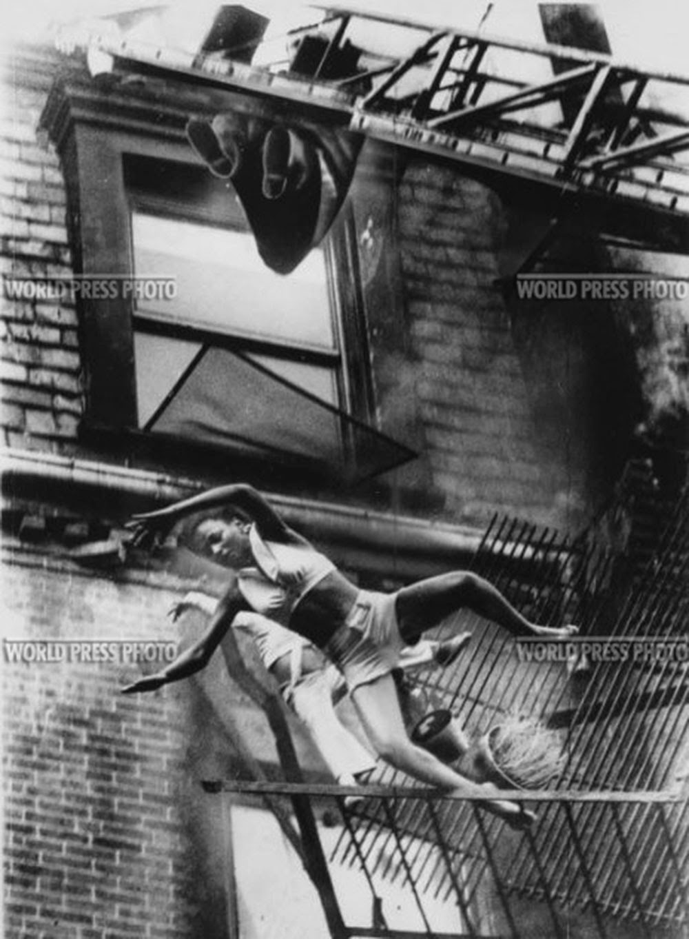 a_mother_and_her_daughter_falling_from_a_fire_escape_1975_4.jpg