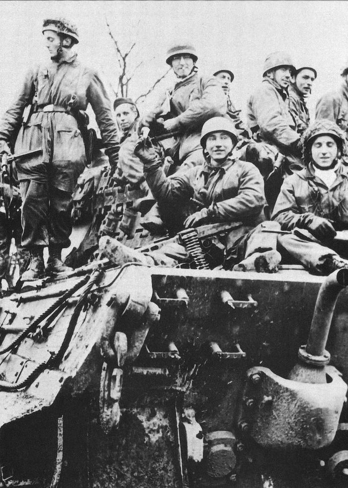 fallschirmjager on a king tiger ardennes dec 1944.jpg