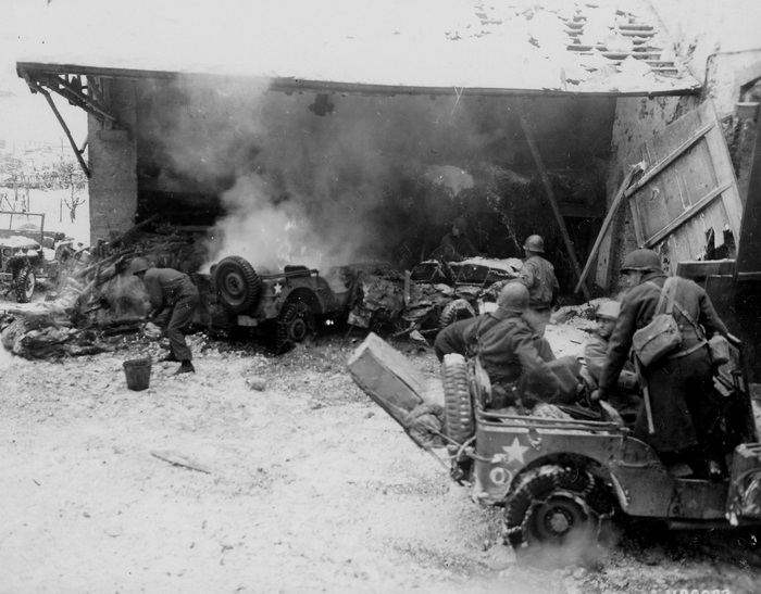 Burning jeeps 26th Inf Div after a German indirect fire attack Wiltz,.jpg