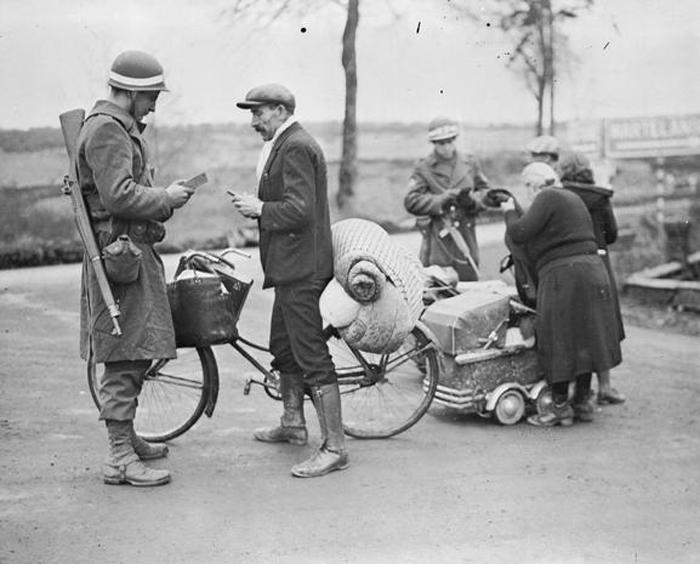 mps checking refugees near bastogne.jpg