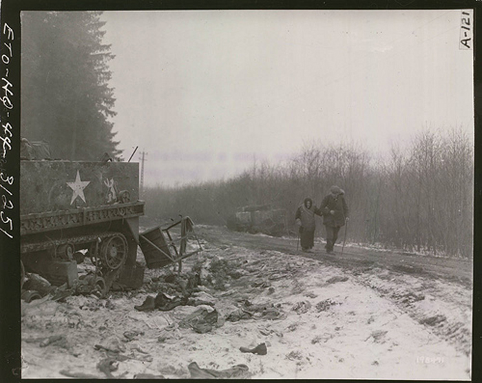 two elderly refugees on the bastogne road 27 dec 1944.jpg