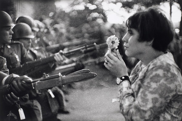 a-vietnam-war-protester-brings-a-flower-to-soldiers-in-washington-dc-on-oct-21-1967-nearly-100000-people-came-out-to-protest.jpg