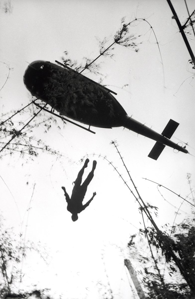 an-evacuation-helicopter-in-vietnam-raises-the-body-of-an-american-paratrooper-killed-in-action-in-the-jungle-near-the-cambodian-border-in-1966.jpg