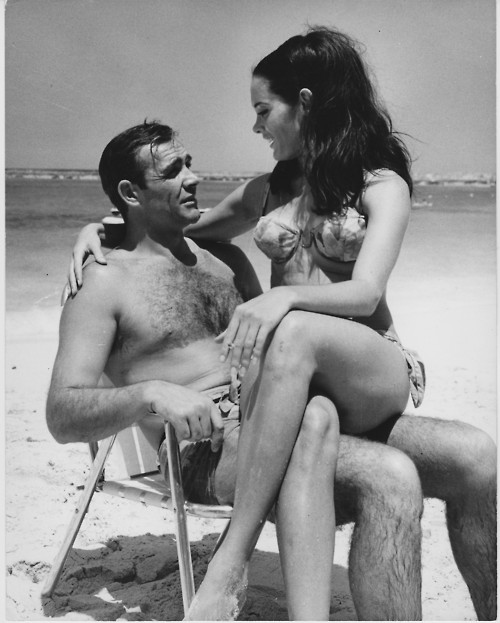 Martine_Beswick_holding_cig_with_Sean_Connery_on_set_of_Thunderball_in_1965.jpg