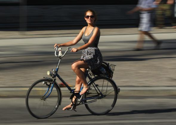117638917-young-woman-rides-a-bicycle-on-a-hot-day-in-the-city.jpg.CROP.promo-mediumlarge.jpg