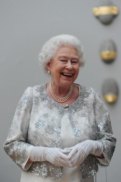 queen_laughing_v_24may12_pa_b_426x639.jpg