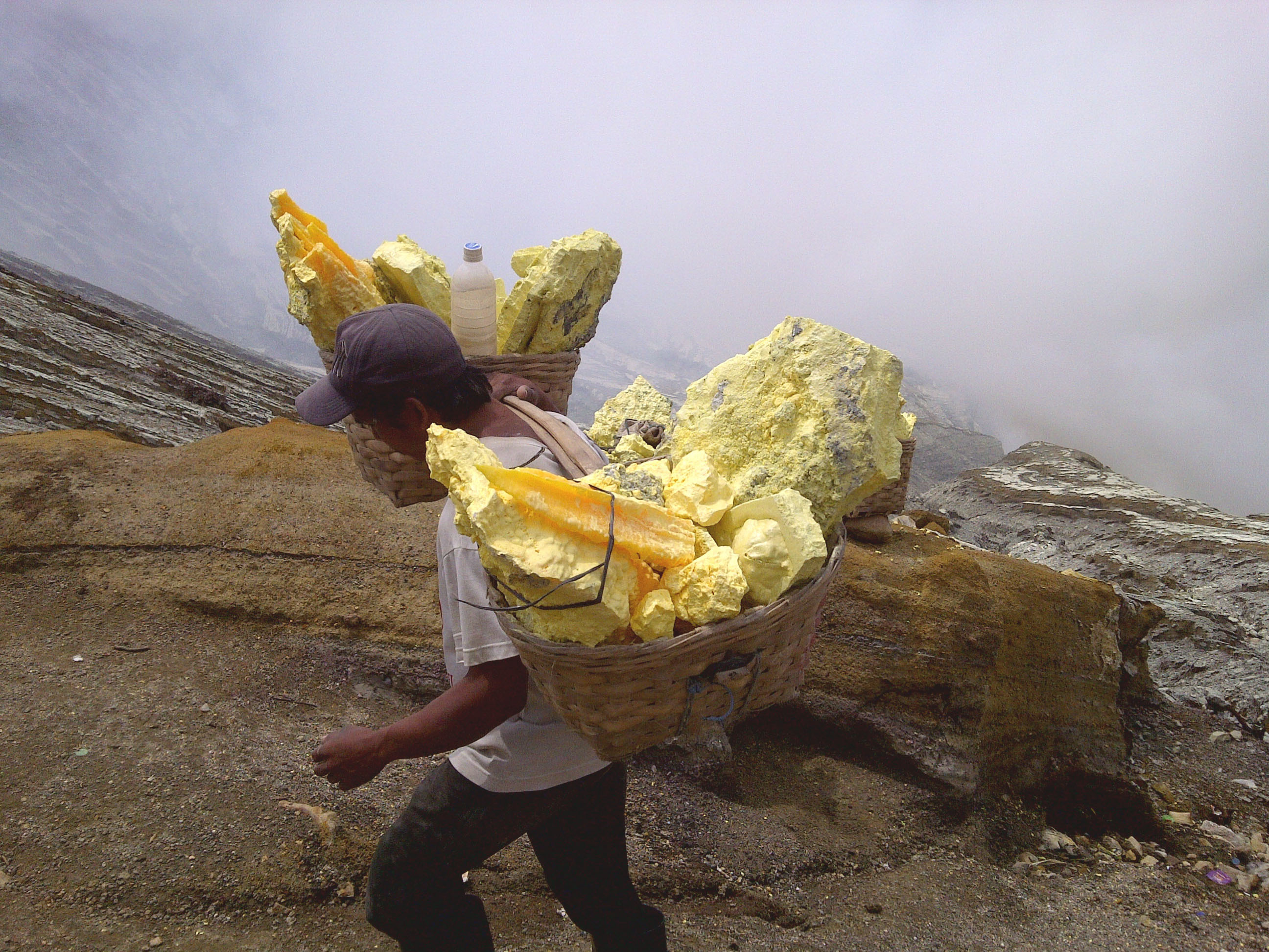 the_sulfur_miner_of_kawah_ijen_mountain_indonesia.jpg