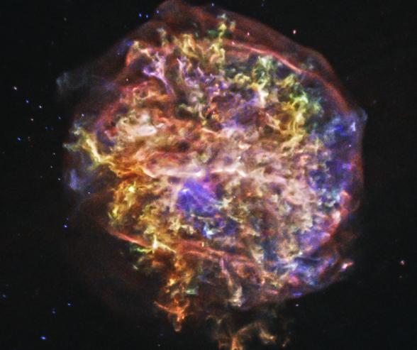 G292.0+1.8. A felhőben található oxigén, ez sárga színnel látszik, magnézium ami zöld és szilícium, illetve kén, kék színnel.