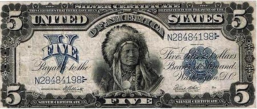 1899. Az egyetlen dollárbankjegy, amelyen őslakos képe szerepel. A római ötös a felirattal a GTA V játék logójában is szerepel..jpg
