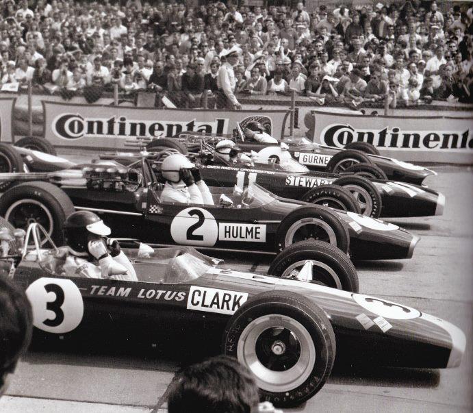 1967. Jim Clark, Denny Hulme, Jackie Stewart and Dan Gurney a Nürburgringen..jpg