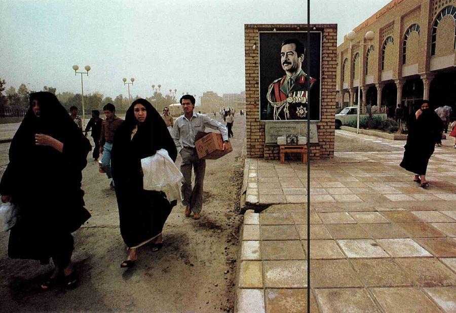 1985. Szaddam Husszein fotója egy újonnan nyitott bevásárlóközpont előtt, Bagdadban..jpg