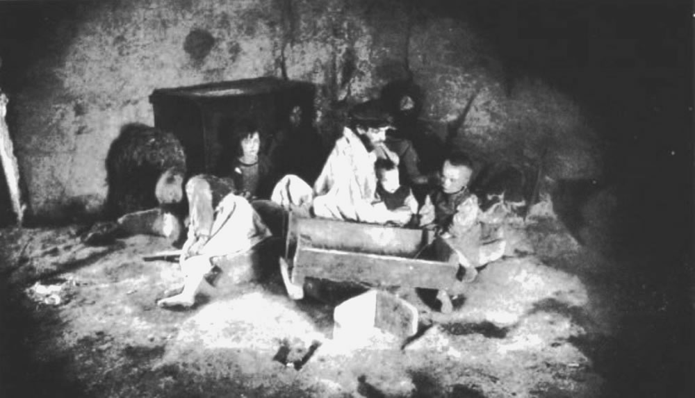 Starving-family-in-Carraroe-County-Galway-during-Great-Famine.jpg