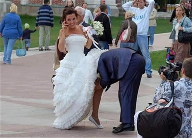 funny-wedding-pictures-groom-taking-off-brides-garder.jpg