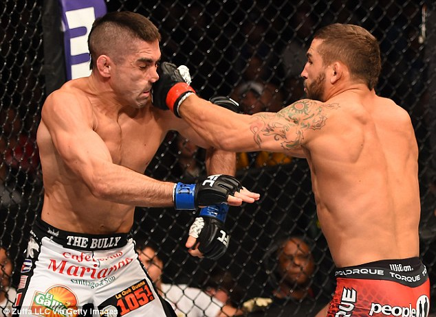 274a4b4000000578-3025976-chad_mendes_punches_ricardo_lamas_in_their_featherweight_fight_d-m-46_1428188134141.jpg