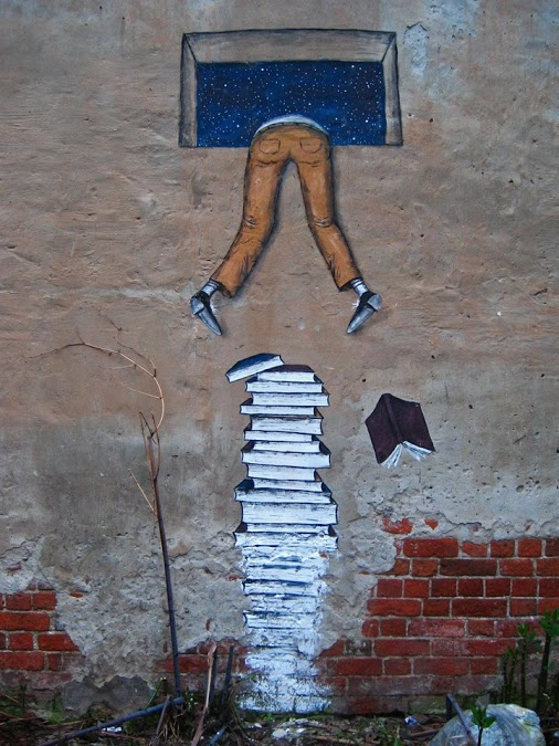 Street-Art-Climb-Over-Books.jpg